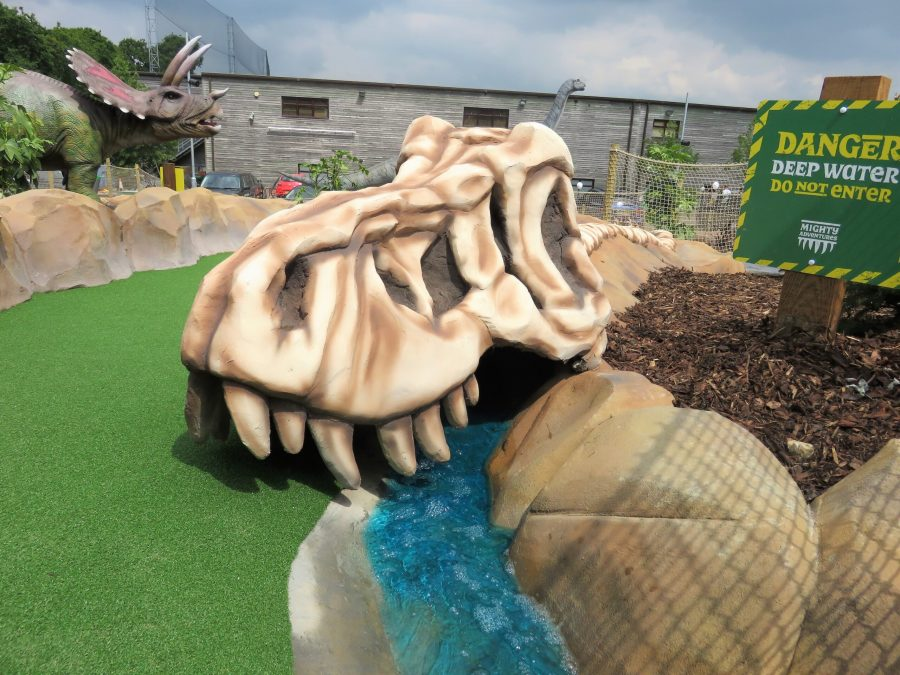 dinosaur skull with water running through it at mighty claws adventure golf