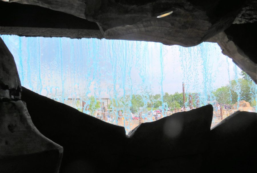 inside the cave looking out at the waterfall at mighty claws adventure golf