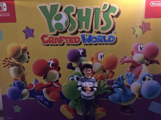 Jake in front of the Yoshi sign