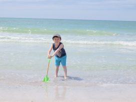 Jake stood in the sea leaning on a spade