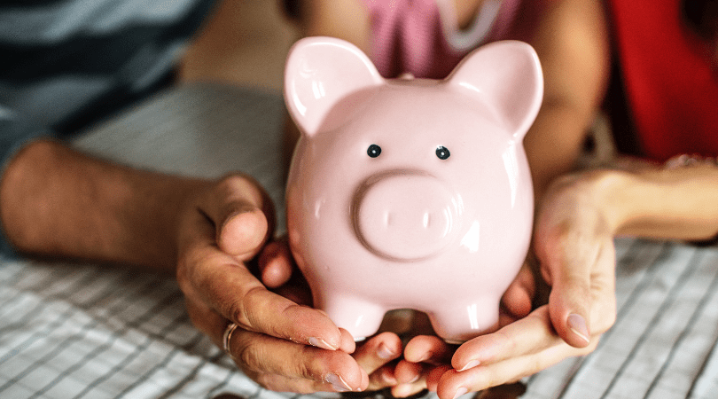 teaching kids the value of money, a piggy bank