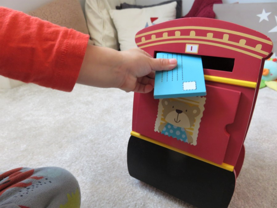 wooden letter box being used by William