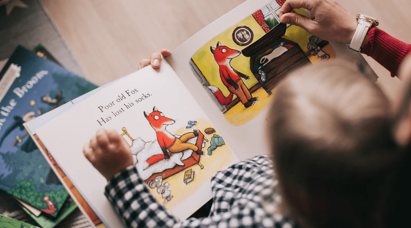 reading a book to a toddler