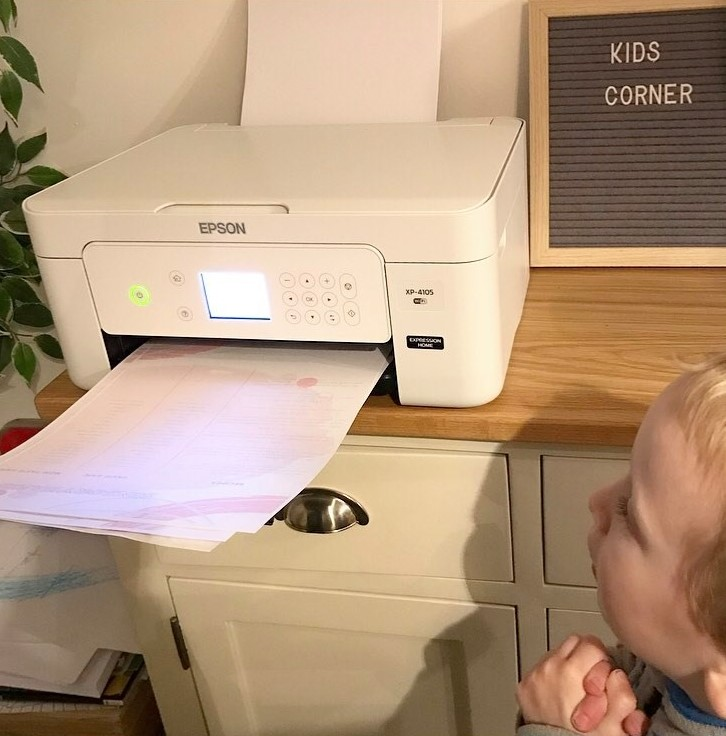 william watching his printout coming out of the printer