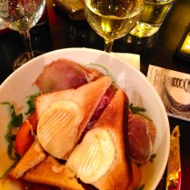 i went lighter (?) with a salad topped with proscuitto and goat cheese toast. again with the yummy (cheap!) Chardonnay. mmm . . .
