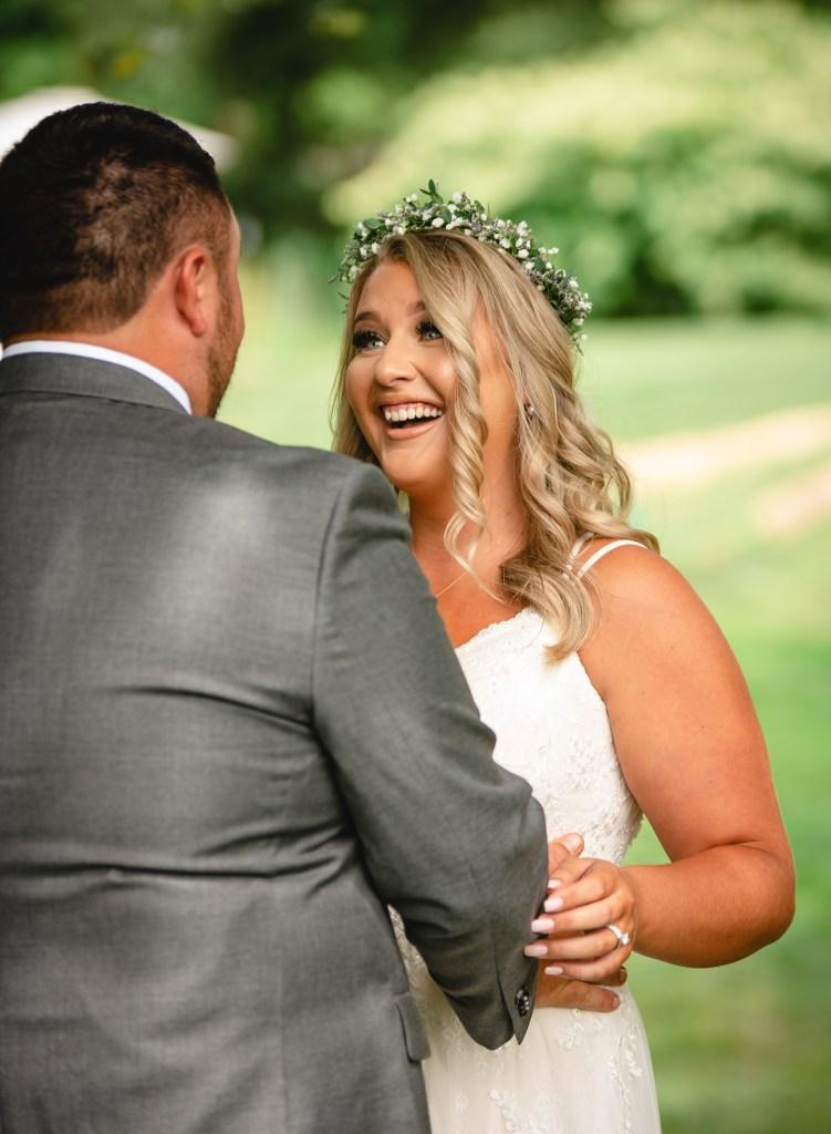 first look at backyard wedding