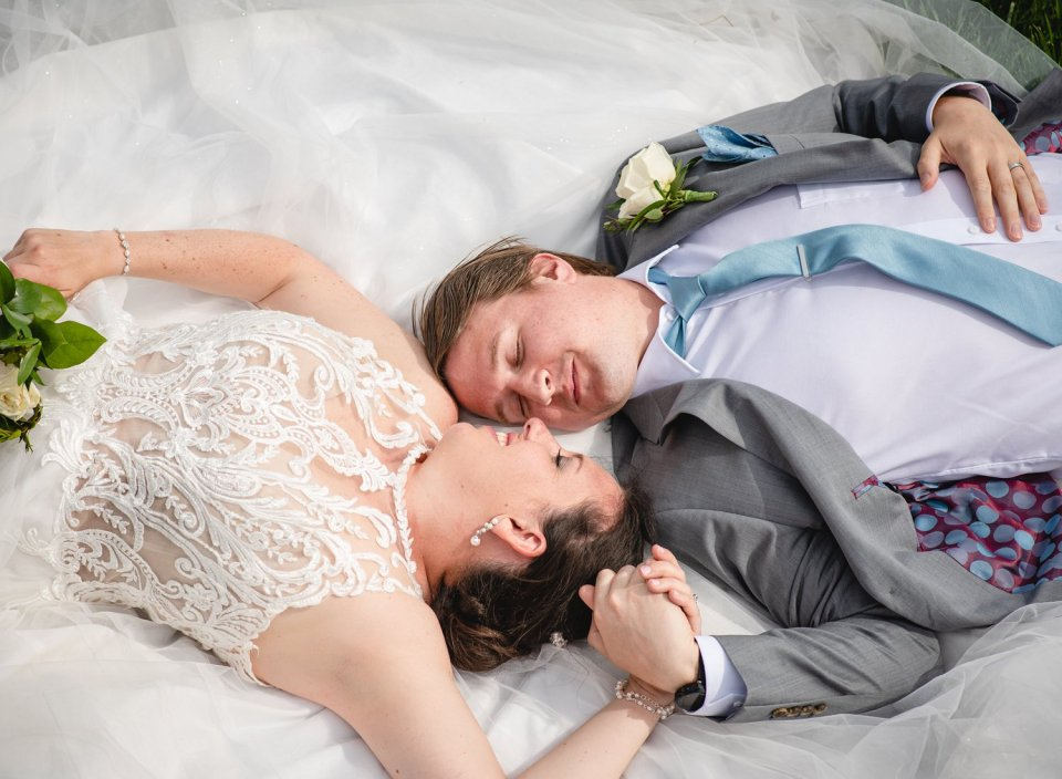 elopement couple laying down together