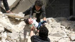 Syrians evacuate a toddler from a destroyed building following a reported air strike on the rebel-held neighbourhood of al-Kalasa in the northern Syrian city of Aleppo, on April 28, 2016. The death toll from an upsurge of fighting in Syria's second city Aleppo rose despite a plea by the UN envoy for the warring sides to respect a February ceasefire. / AFP / AMEER ALHALBI (Photo credit should read AMEER ALHALBI/AFP/Getty Images)