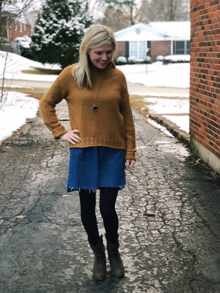 sweater layered over dress