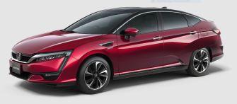 Honda Clarity - Fuel Cell, Brennstoffzellen Auto, seitlich von vorne, Autofarbe rot metallic, Hintergrund grau - Elektroauto, Hybrid, Brennstoffzelle, Wasserstoff, H2, Foto Honda