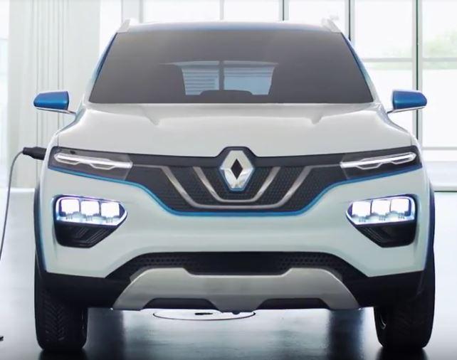Renault, Dacia - K-ZE - erstes Elektroauto für weniger als 10000 Euro, platt von vorne , Dach in blau, Auto sonst in weiß metallic