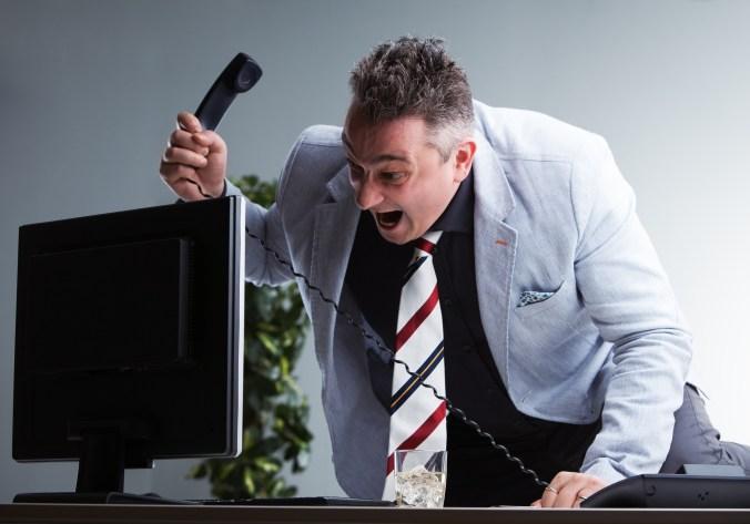 Hostile-aggressive man in office