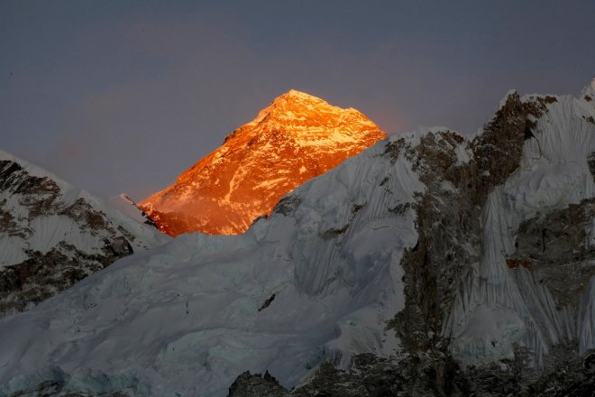 In this Nov. 12, 2015 file photo, Mt. Everest is seen from the way to Kalapatthar in Nepal. Climbers are making good progress on Mount Everest and the first group could reach the summit as early as Thursday, following two years of disasters on the world's highest mountain, a mountaineering official said Tuesday. Nearly 300 foreign climbers and their guides are attempting to reach the 8,850-meter (29,035-foot) summit. (AP Photo/Tashi Sherpa, file)