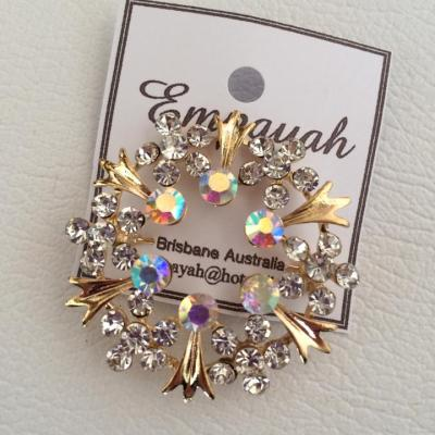 Fine halo style gold and rhinestone brooch