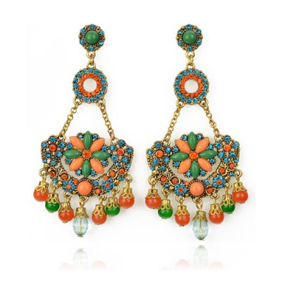 Indian inspired statement earrings in green and orange set in gold