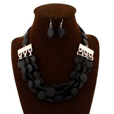 Stretch round disc necklace and earring set in black