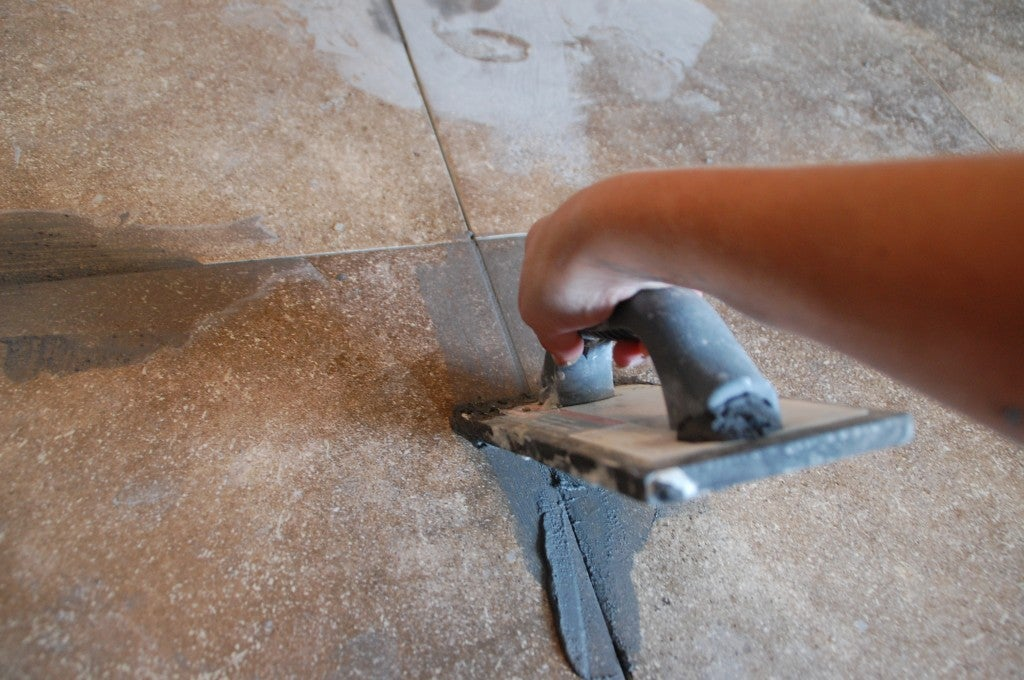 see how to grout tile in this diy photo