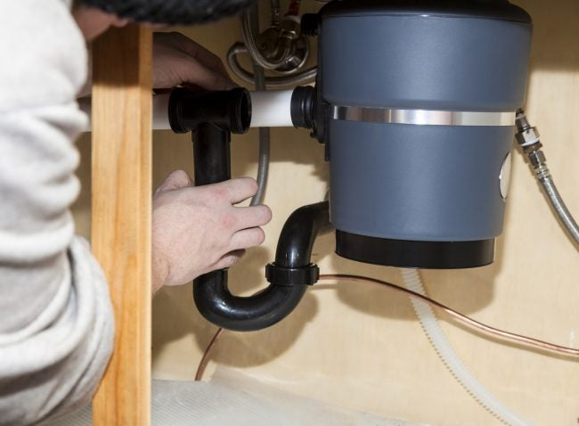 replacing a garbage disposal read this