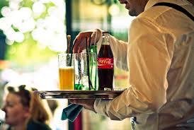 Waiter Serving at Restaurant