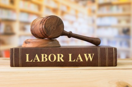 Labor,Law,Books,With,A,Judges,Gavel,On,Desk,In