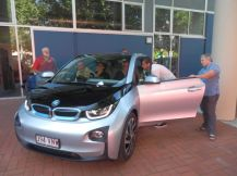 John with admirers of his BMW i3.