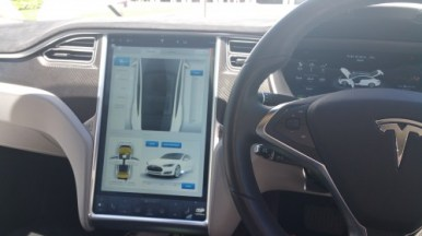 """Dash and 17"""" display screen inside Tesla Model S - most of controls are done via the touch screen."""