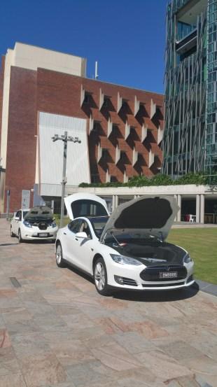 Tesla Model S with Nissan Leaf behind.