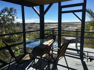 screen enclosed patio with a spectacular view