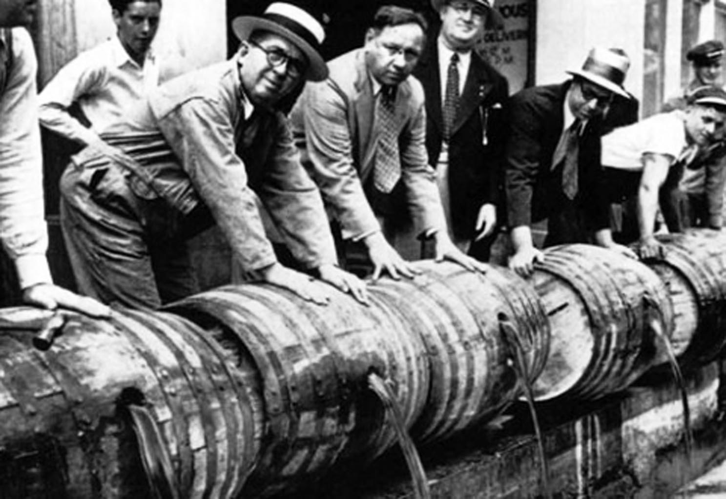 Prohibition agents emptying liqueur barrels
