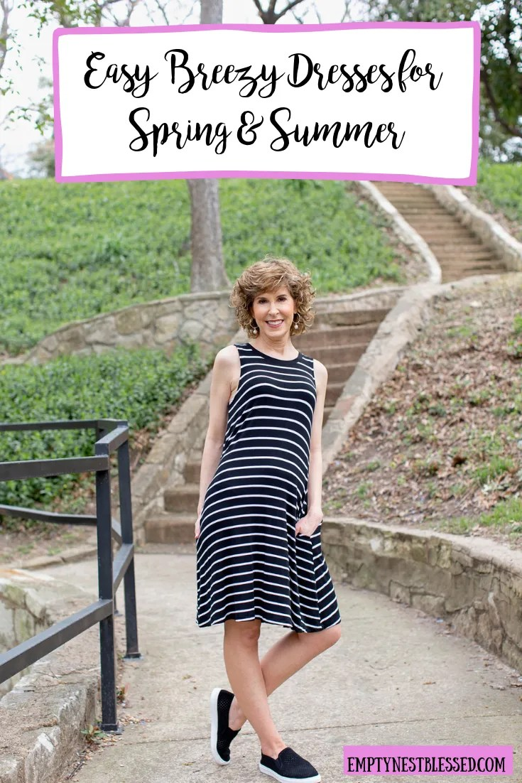 woman wearing black and white striped dress with graphic text
