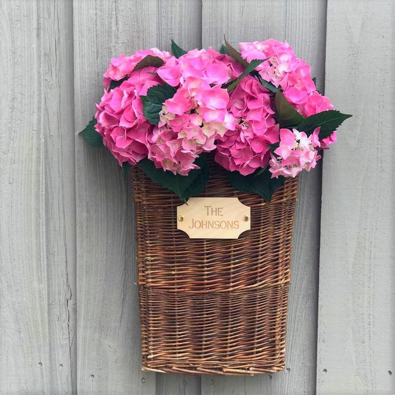 willow door basket full of pink hydrangeas