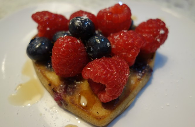 blueberry pancake topped with fruit