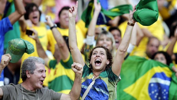 Brazilian supporters cheer while watching a penalty shootout after regulation time between Brazil and Chile before the World Cup round of 16 soccer match between Colombia and Uruguay at the Maracana Stadium in Rio de Janeiro, Brazil, Saturday, June 28, 2014. (AP Photo/Marcio Jose Sanchez)