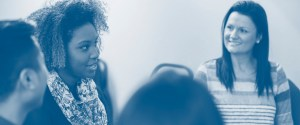 Women taking part in a group discussion - blue tone.