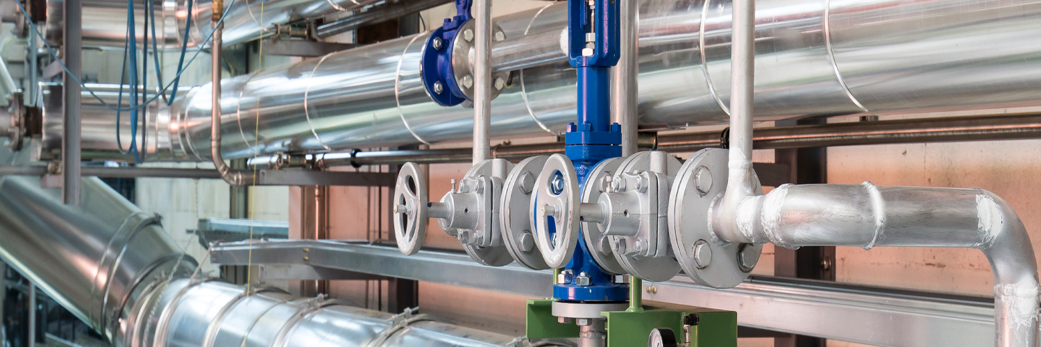 Image of Pipes and valves represent the piping products that we sell.