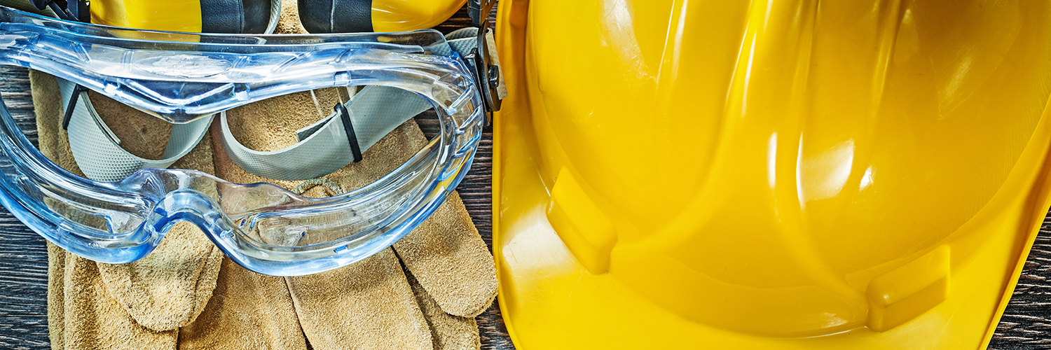 Image of hard hat, safety goggles and gloves.