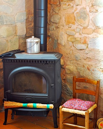 stove and chair in living room