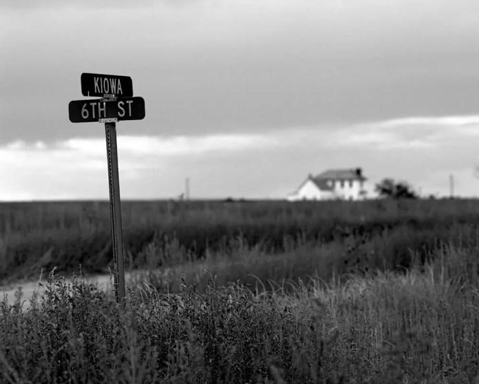 Signs still mark abandoned streets - Arlington, Colorado. Pentax 6x7, 45mm f/4, Ilford Pan F Plus