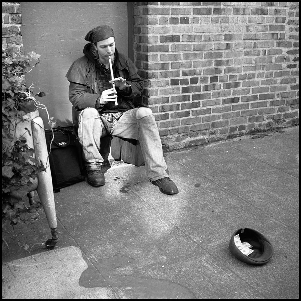 "Iford HP5, Rolleiflex TLR, ""The Cap Charmer"" from ""A Little Street Music"""