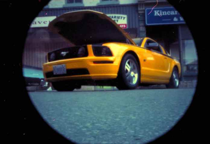 Yellow Mustang at the Kincardine Show and Shine.