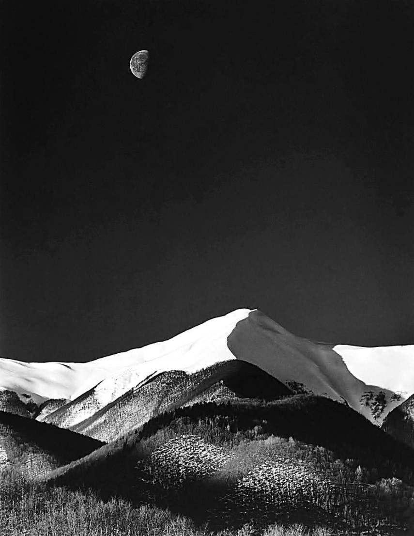 AB - Snow covered mountains and the moon.