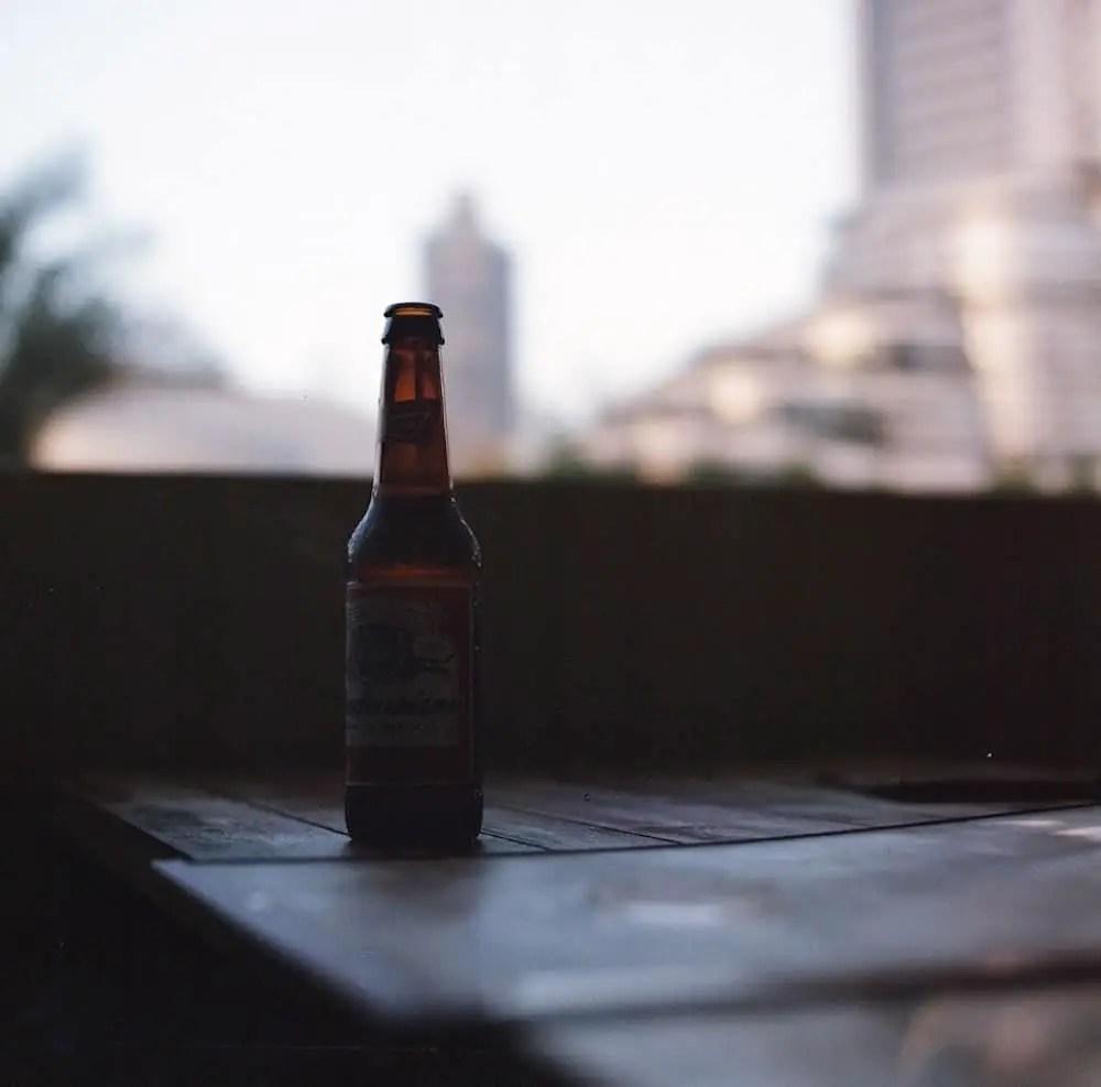 """""""Bottle on Table"""" Claw Grill, Dubai, April 2015 - Hasselblad 500CM/ 80mm Zeiss Planar / Lomography Colour Negative 400"""