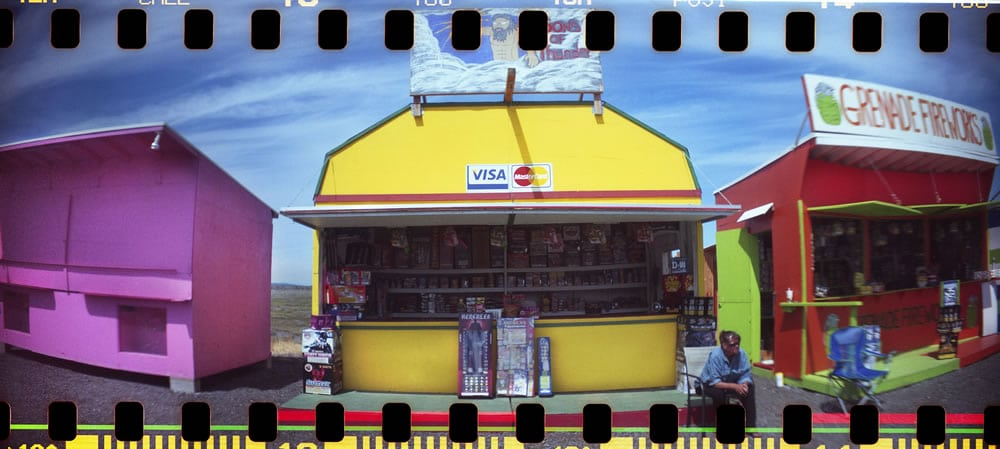 """Swinomish Fireworks' Selling Huts, With Sprockets,"" Sprocket Rocket camera, Fuji 100"