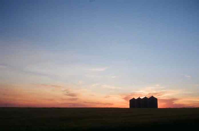 Sunset with grain bins - Canon Canonet 28 - Fuji Superia 200