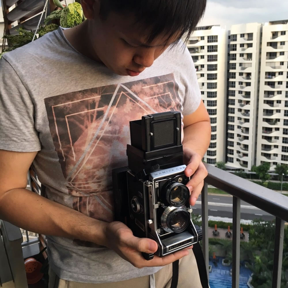 Damian using the Mamiya C33 Instant Back; it certainly caught a lot of attention when we were using it in public!