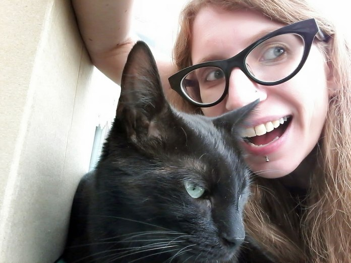 And here's a picture of me, it's a dorky selfie with my cat Loa!