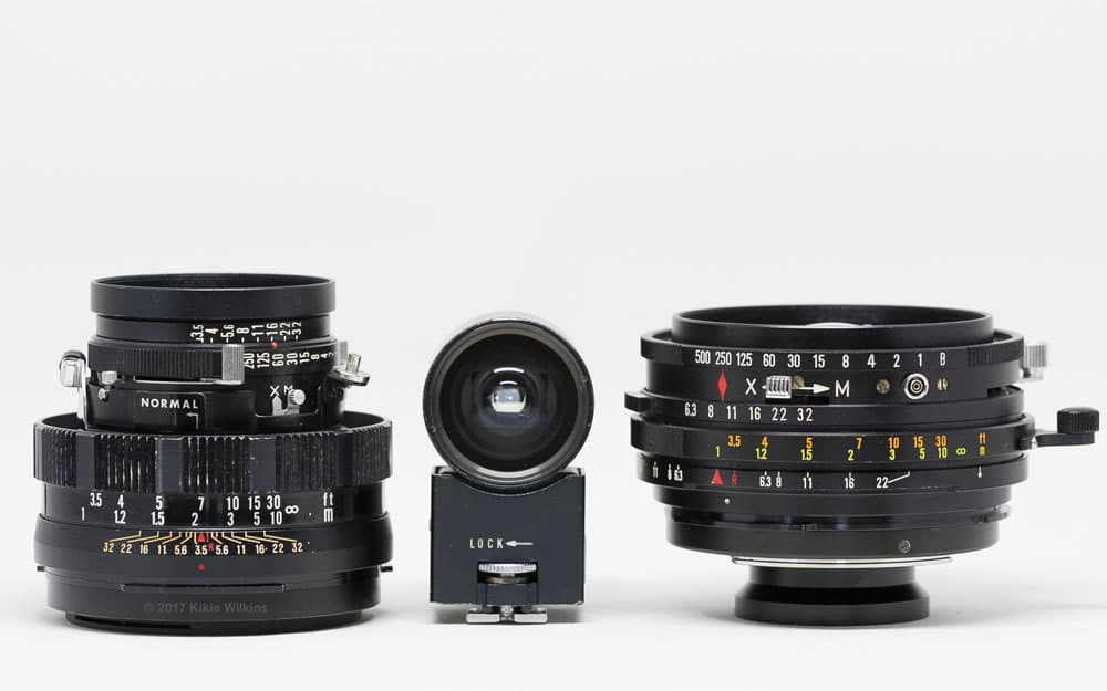Mamiya Sekor 100mm f/3.5 (updated model), 50mm accessory viewfinder, and 50mm f/6.3 lenses