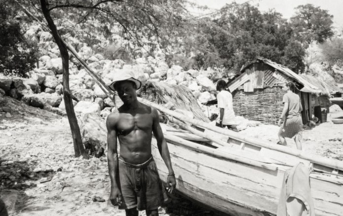 Fisherman in Haiti by his boat - Kodak BW 400CN Disposable
