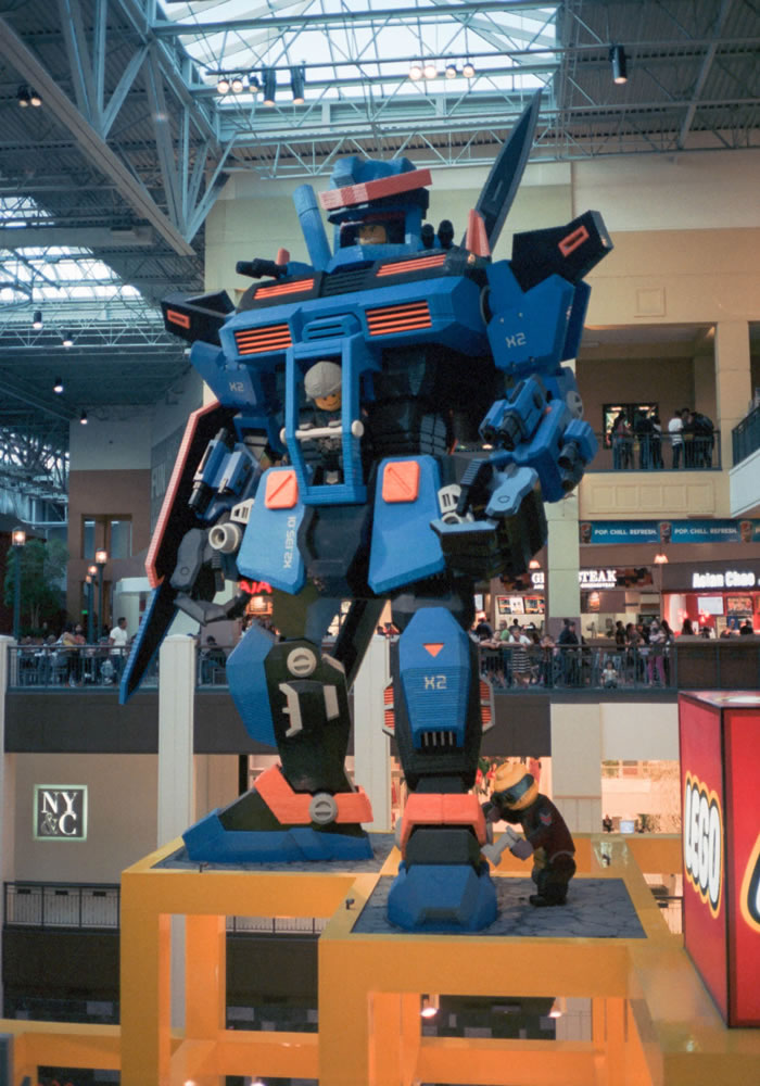Minolta Hi-Matic - Indoor, ambient light, no flash - Kodak Portra 400. Lego Robot Hero at Mall of America, Minnesota, USA