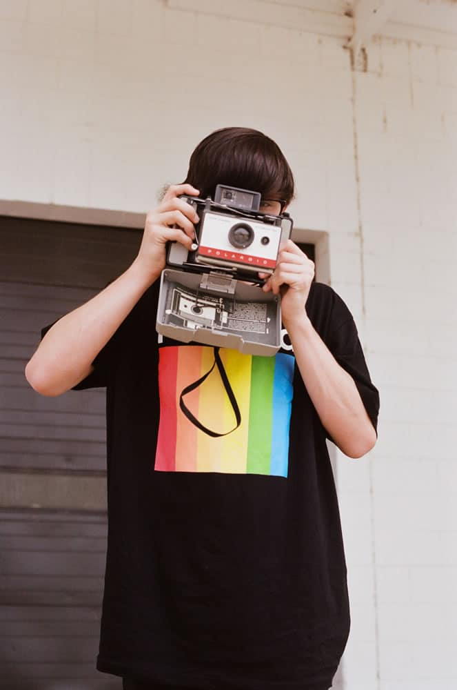 Son with Polaroid Land Camera